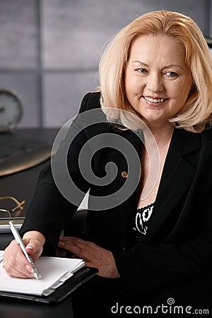 Senior businesswoman taking note