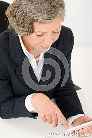 Senior businesswoman touch-screen tablet computer