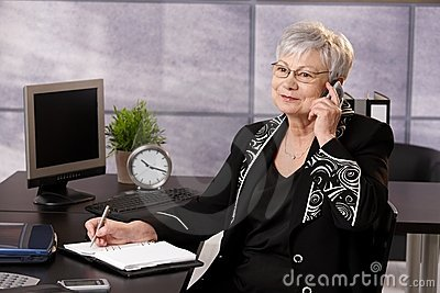 Senior businesswoman using cellphone