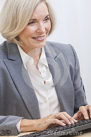 Senior Businesswoman Using Computer
