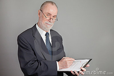 Senior With A Checklist Stock Photo - Image: 23337560