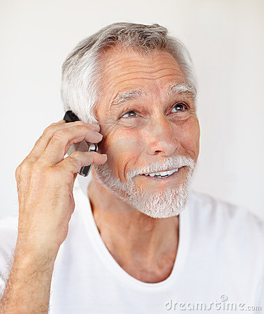 A senior cheerful man speaking on a mobile