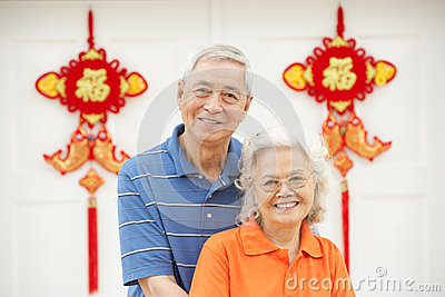 senior chinese couple outside home with feng shui thumb26246333 Feng Shui Remedy For Cul De Sac