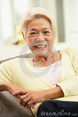 Senior Chinese Woman Relaxing At Home