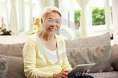 Senior Chinese Woman With Tablet Computer