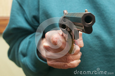 Senior Citizen Holding A Gun