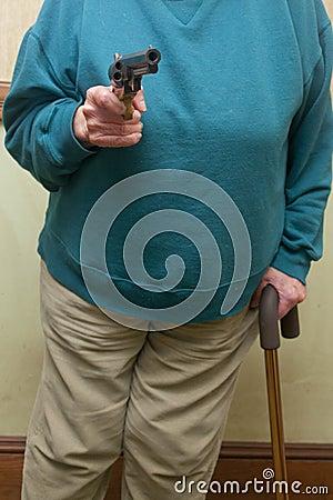 Senior Citizen Holding A Gun