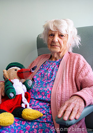 Senior citizen with toy