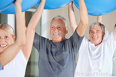 Senior citizens exercising with gym