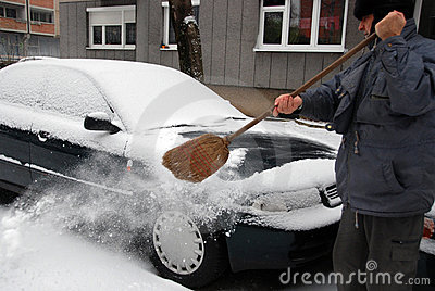 Senior clearing snow
