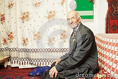 Senior contented man on sofa