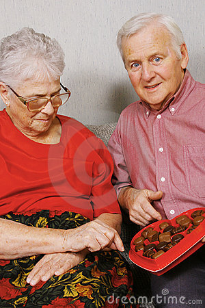 Free Senior Couple And Chocolate Royalty Free Stock Photography - 4125047