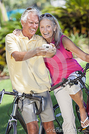 Free Senior Couple Bicycles Taking Digital Camera Picture Stock Images - 28878514