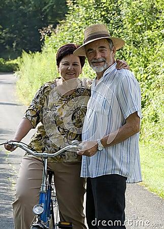 Senior couple bicycling