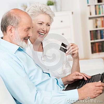 Senior couple buying online