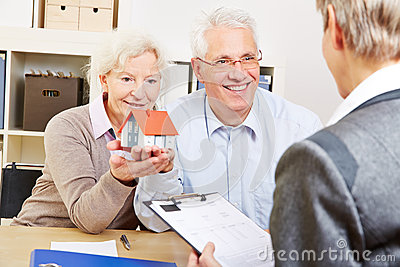 Senior couple buying real eastate