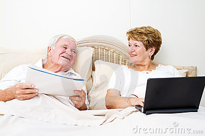 Senior couple chatting in bed
