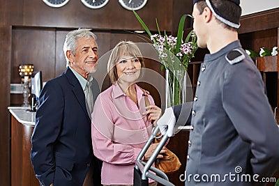 Senior couple at check-in at hotel