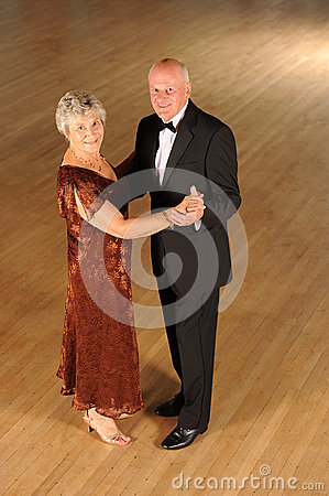 Senior couple in dance pose