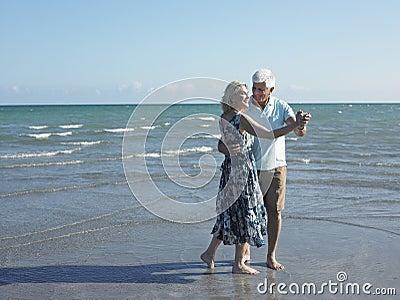 Senior Couple Dancing On Tropical Beach