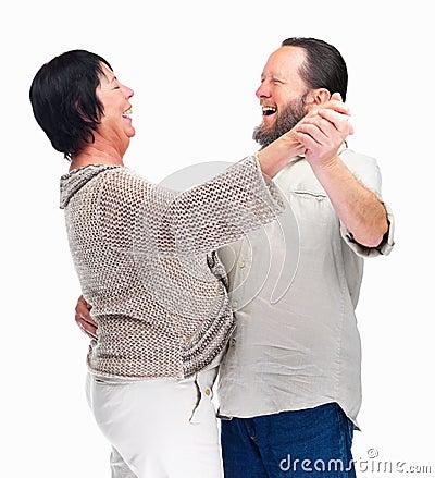 Senior couple dancing on white background