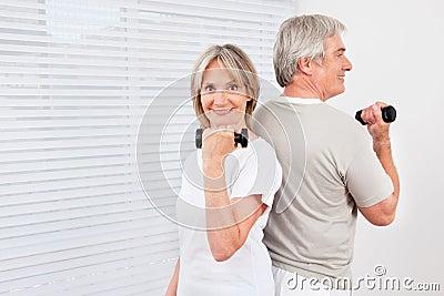 Senior couple doing dumbbell
