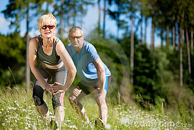 Senior couple doing sport exercising outdoors