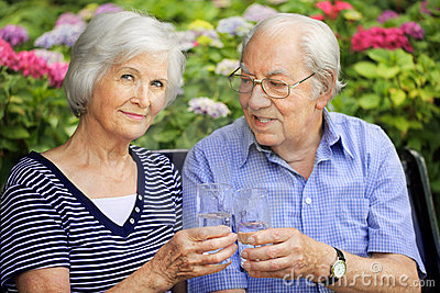 Senior couple with drinking glasses