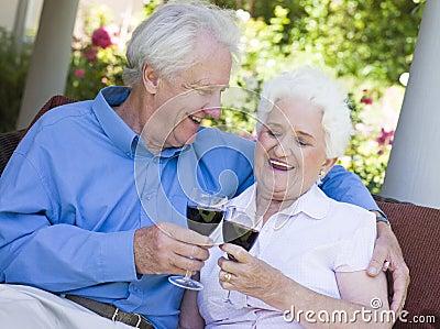 Senior couple drinking red wine
