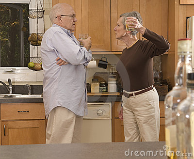 Senior couple drinkling, fighting