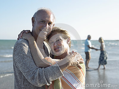 Senior Couple Embracing On Tropical Beach