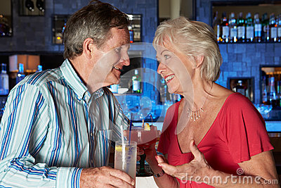 Senior Couple Enjoying Cocktail In Bar