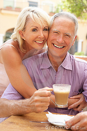 Senior Couple Enjoying Coffee And Cake