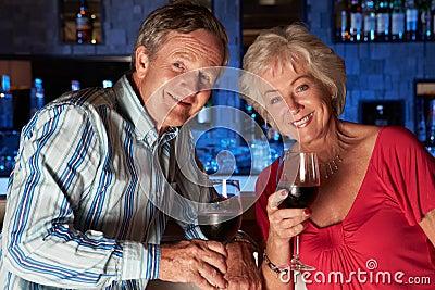 Senior Couple Enjoying Drink In Bar