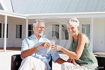 Senior couple enjoying a glass of champagne