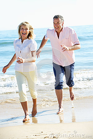 Senior Couple Enjoying Romantic Beach Holiday