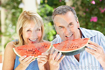 Senior Couple Enjoying Slices Of Water Melon