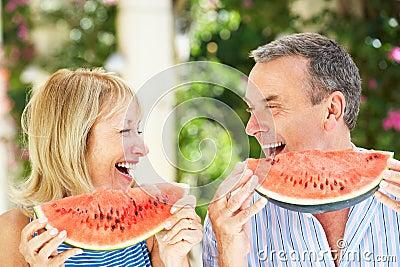 Senior Couple Enjoying Slices Of Water Melon