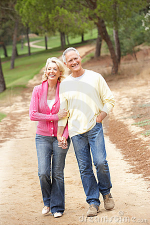 Senior Couple enjoying walk in park