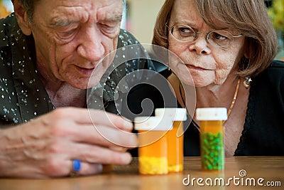 Senior couple examining medications