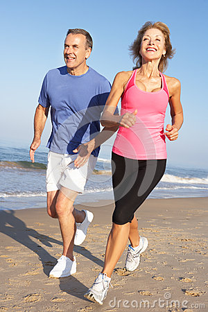 Free Senior Couple Exercising On Beach Royalty Free Stock Photo - 27201185