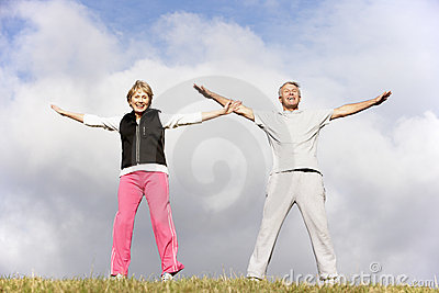 Senior Couple Exercising In The Park