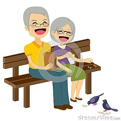 Free Senior Couple Feeding Birds Stock Images - 56566484
