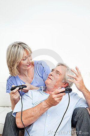 Senior couple with game controller