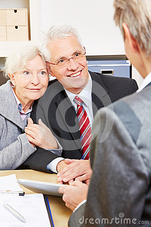 Senior couple getting advice from