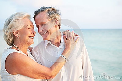 Senior Couple Getting Married In Beach Ceremony