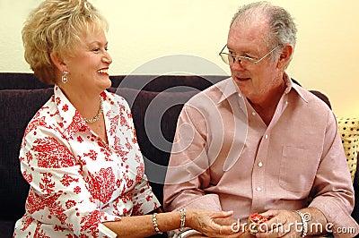 Senior couple gift giving