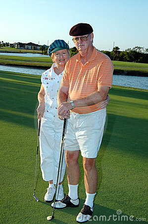 Senior couple golf
