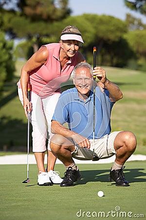Free Senior Couple Golfing On Golf Course Royalty Free Stock Photos - 16304168