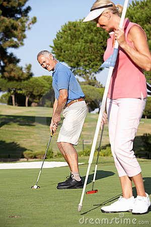 Free Senior Couple Golfing On Golf Course Royalty Free Stock Image - 16304256